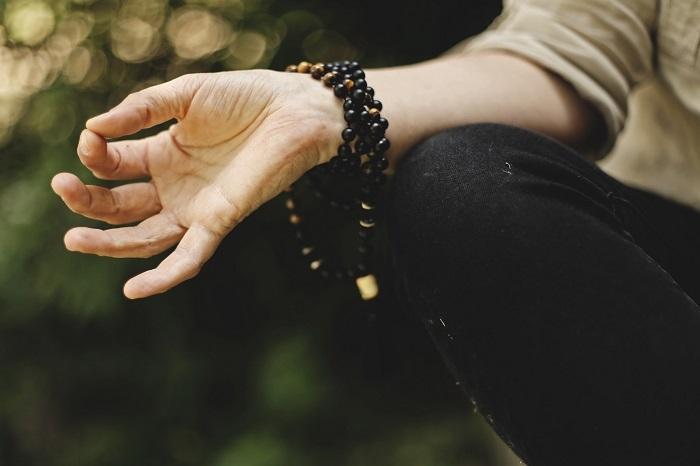 mudra hand wearing beads