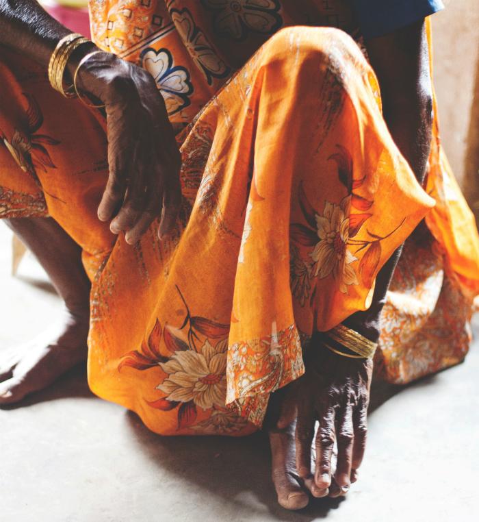 squat old lady orange clothing
